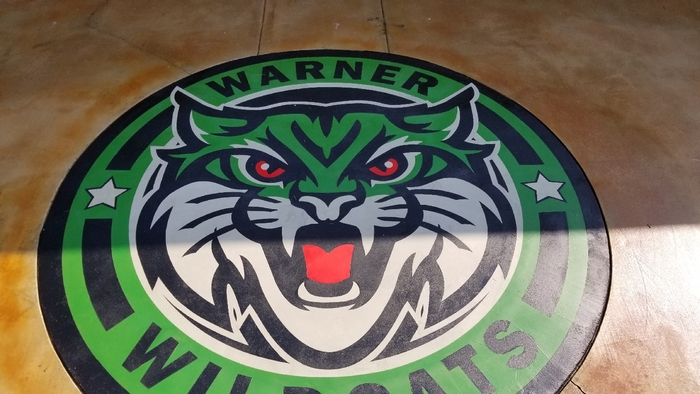 Warner Wildcat logo in concrete