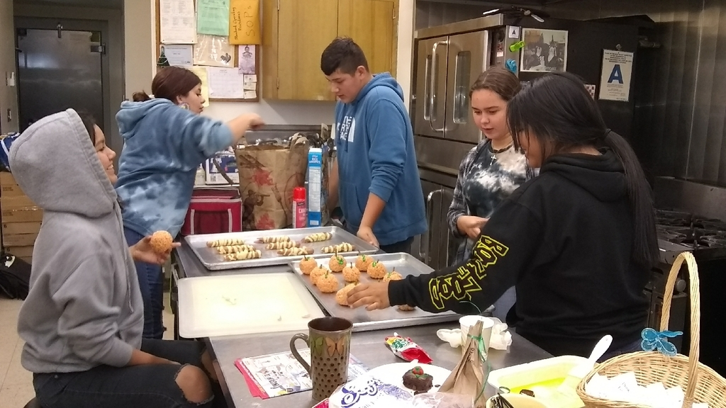 AVID students making Rice Krispie pumpkins and mummy dogs for Halloween